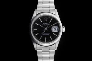 Rolex Date (34mm) Ref.: 15200 aus 1997 mit schwarzem Zifferblatt und glatter Lünette