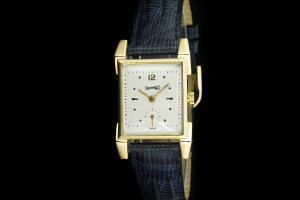 Eberhard & Co. Vintage (22x25mm) in 14k Geblgold mit Lederband
