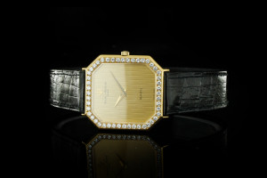 Baume & Mercier Vintage Lady (28x29mm) in Gelbgold mit Diamantlünette