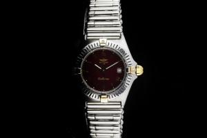 Breitling Callistino (29mm) Ref.: B52043 Damenuhr mit rotem Zifferblatt in Stahlgold mit Papieren aus 1991